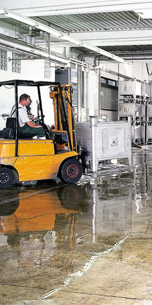 Forklift Driving Over Long Lasting Commercial Floor
