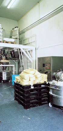 Large Commercial Bakery With Some Flour Spilled On The Quality Floor Coating.