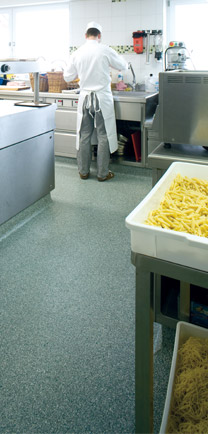 Pasta Being Preped In A Commercial Kitchen That Utilizes Eco-Friendly Flooring.