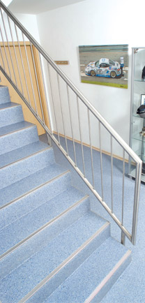 Firehouse Flooring Utilized On Stairs And In A Hallway.