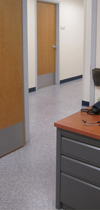 Healthcare Design Flooring Shown In A Doctor's Office Hallway.