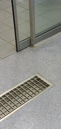 Close Up Of Transportation Terminal Flooring Where Seamless Flooring Meets Tile.