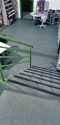 Stairway Flooring With Rubber Safety Strips.