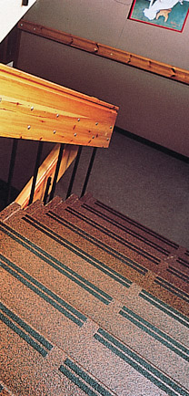 Stairway Flooring That Matches The Decor Of The Thick Wooden Railing.