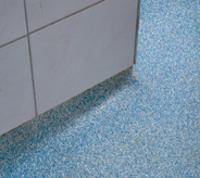 Blue acrylics bring color to an impregnated flooring system.