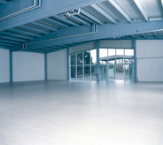 Hangar aircraft warehouse shines blue with new floor coat.