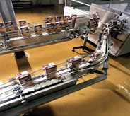 Products fly by on machine on top of assembly line flooring.