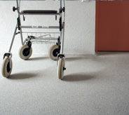 Walker on assisted living flooring.