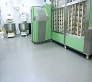 Commercial mixers sit on top of bakery flooring.