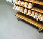 Bread cart moves easily across bakery flooring.