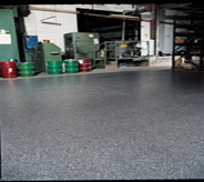 Bright grey floor coat protects previously cemented store room.