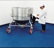 Inspector fills forms after inspecting chemical mixer resting atop blue resistant flooring