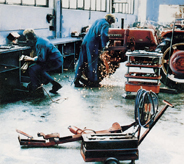 Workers using welding machine on top of climate adaptive flooring.