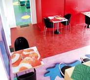 Concrete sealer brightens colored floor decals in posh cafe setting.