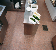 Orange flaked commercialed floor system protects kitchen prep area.