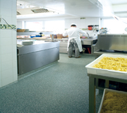 Commercially designed kitchenette flooring protects against harm for working prep cook.