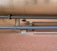 Covered flooring system surrounds industrial concrete equipment.