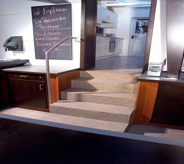 Concrete floors blend from conference room to break area and even up stairs.