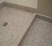 Shower floor of decontamination area is accented with proper drainage.