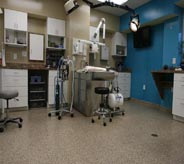Medical equipment sits on top of a flake floor in this doctor's office.