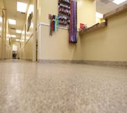 A clean floor shines in this empty emergency room waiting area.