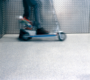A kick and go trolly cart briskly moves across areas of covered flooring showing zero high traffic wear.