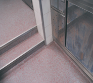 Light maroon floorings complete access steps for a commercially designed project.