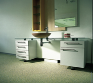 Office bathroom area presents cool setting with seamless floor system.