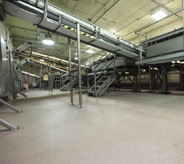 Gray floor inside food production plant.