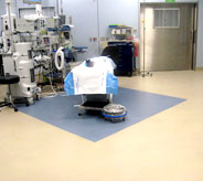 yellow hospital floor with x-ray machine coming from celling