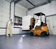 Driver operates forklift across impact resistant floor.