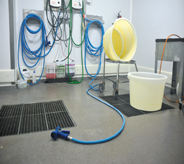 Low maintenancing system displays large floor draining grates and various cleaning accessories.
