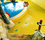 Yellow museum floor with blue waterfountain.