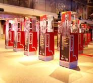 Sports meseum with display cases on cream colored floors.