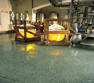 Nuclear equipment sit atop a green floor in this facility.