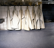 Aprons hang just above floor in a nuclear facility.