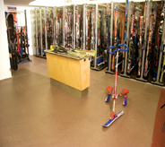Ski shop displays assorted skis's atop gorgious earth toned commercial seamless floor.
