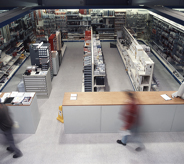 Commercialed wholesale warehouse shines beneath artifical light reflecting off a seamlessly installed flooring system.