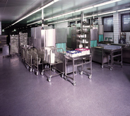 Commercial kitchen flooring seamlessly blends cool color with stainless steel surroundings.