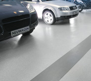 Cars parked on showroom flooring.