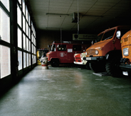 Heavy trucks are parked on a stress resistant floor.