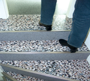 Stones look alike comprise floor coating over concrete stairs.