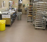 Bakery racks and decorating shelf sits on supermarket floor.